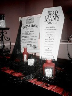 Halloween décor MD....use the coffin shape for your table numbers or printed menu on tables???