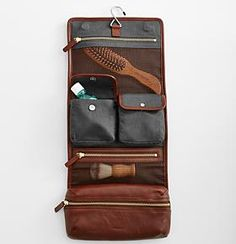 Leather Toiletry Travel Case $129.95 Carry your grooming supplies conveniently and handsomely with this Leather Toiletry Travel Case. This fold-up case has multiple pockets with tumbled nickel/antique brass hardware. It has a handle, convenient hook, mesh pockets, magnetic closure, and even a removable inner pouch. Unfold and use the enclosed hook to hang it for […]