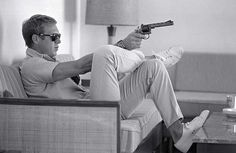 Steve McQueen was also known for for having a anti-hero persona, but his approach to style was unique. Unlike Dean and Brando, McQueen excelled at taking classically un-rebellious sportswear and giving it edge. In addition to leather jackets and jeans, Steve McQueen rocked pale colored button downs, cardigans, v-necks, polo-shirts, and khaki's.