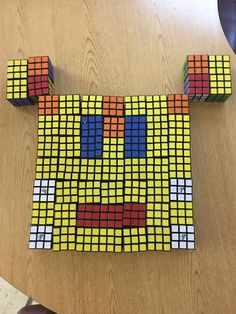 Face from 57 Rubik's Cubes  mosaic - Click for more designs