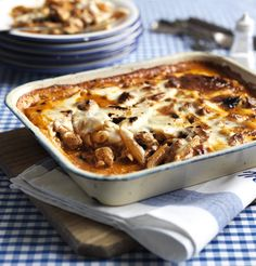 A filling pasta dish with rich tomato sauce and sausagemeat baked in a creamy white sauce