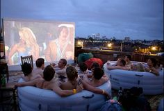 Want to watch movies, in a hot tub, on a rooftop?