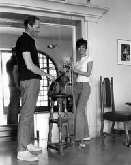 Mel Ferrer photographed with his wife Audrey Hepburn and Assam of Assam by Pierluigi Praturlon at the beach house of the actress and former model Capucine. French Riviera (Cte dAzur), June 1966.  -Audrey was wearing Herms sailor pants (of the collection for the Spring/Summer of 1965) and Cline flats.  Note: Audrey was in the French Riviera for the filming of Two for the Road.