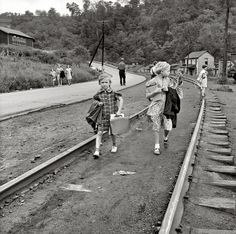"September 1938. Osage, West Virginia. ""Mining town. Coming home from school."" Medium format nitrate negative by Marion Post Wolcott."