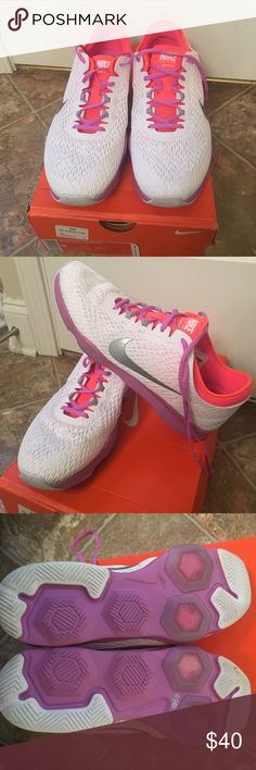 NIKE Zoom Fit size 9 New With Box NIKE Training Zoom Fit size 9. White, purple, and orange. Silver swoosh. Brand new. Never worn. Make me an offer. Nike Shoes Athletic Shoes