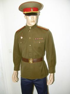 Soviet land forces (Corps determined by embroidered insignia on shoulder board or lack of it) General rank officer field uniform worn until 1958 uniform regulations implemented. Trousers & shoes or breeches & boots were permitted with the General's pull-over tunic. This form of uniform was rarely ever seen in public.
