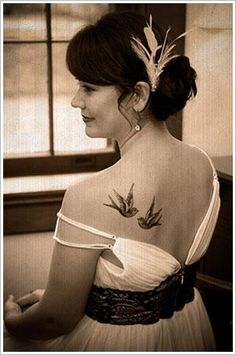 I never wanted a tattoo, but I'd actually considered getting swallows on my shoulder like this. I like how timeless, vintage, and pretty it looks without being too frilly or the opposite - too heavy.