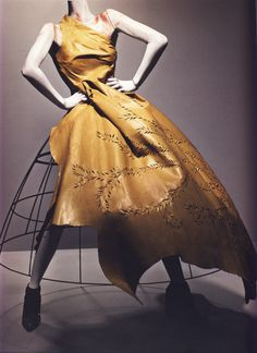 "Alexander McQueen Autumn/Winter 2000-01  Ensemble, Eshu Dress of beige leather; crinoline of metal wire   Photographed by Sølve Sundsbø for Alexander McQueen: Savage Beauty   ""I like things to be modern and still have a bit of tradition.""   ""I believe in history."""