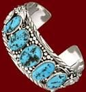 Genuine Turquoise in Sterling Silver, hand crafted by a Navajo person in New Mexico, USA. Get great jewelry at La Zia Stores in Tucson, Az and Mesilla, NM.