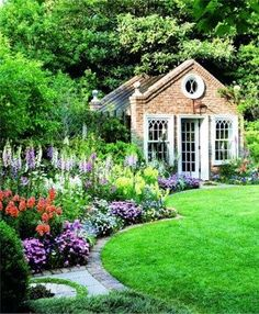Cottage garden plants frame this curvaceous lawn and sensational summerhouse #gardens