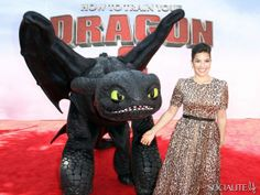 I like to imagine that America Ferrera is smiling so widely because she's terrified of that super creepy dragon. So cute in the movie, so creepy in real life.