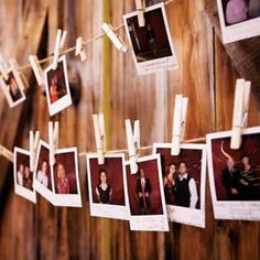 guests first take a polaroid of themselves. when they find their escort card and unclip it, they replace it with the polaroid.