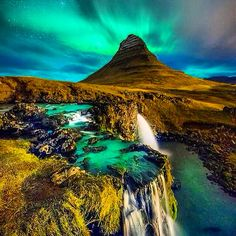 The northern lights dancing over Icelandic nature. Have you ever been to Iceland?