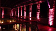 Up lighting in pink at the Clyde Iron Works. Duluth, MN Circle of Hope, Breast Cancer fundraiser event. Lighting by Duluth Event Lighting. www.dulutheventlighting.com wedding lighting, bridal lighting, reception lighting. Wedding photography.