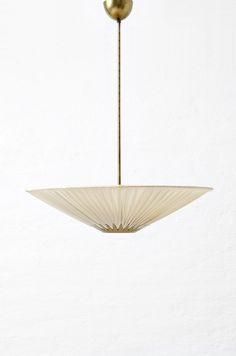 Art Deco ceiling lamp in brass and beige fabric produced in Sweden