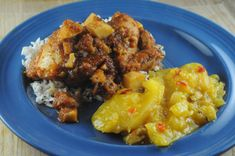 A chicken stew with spicy mangoes on the side. Travel by Stove: Recipes from Guinea.