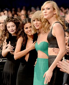 Lorde, Selena Gomez, and Karlie Kloss supported Taylor Swift as she went up to receive the Dick Clark Award at the 2014 AMAs.