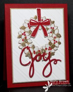 This wondrous wreath has 3 layers of heat embossing and the white panel has striped textured embossing.