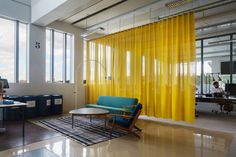 Acoustic curtains by Texaa® #architonic #nowonarchitonic #interior #design #furniture #acoustic #curtain #textile #fabric #yellow #room