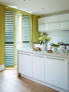 kitchen shuttters for patio doors The-California-Company-Classic-Poplar-Wood-Shutters-With-Privacy-Fit-Slats-In-Custom-Colour-Paint