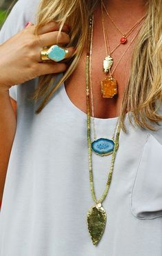 Awesome necklace decorated by a Boho chic and love the blue color ring