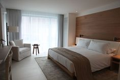 The new Miami Beach Edition Hotel. The wood and upholstery are lighter and the room feels brighter.