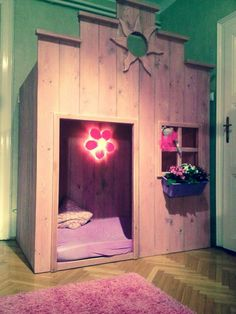 Bunk bed hidden in a small rustic pink house