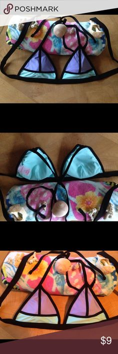 SOLD ON Ⓜ️👙Beautiful! Color Block Bikini👙Top 👙FIRST PICTURE DEPICTS TRUE COLOR:) Beautiful Color Block Bikini top in lovely Lavender 💜 Black, and Aqua🐬 EUC! See pic. 4 close up... Not pulls, not snags, not rips... It was just like that when purchased! Didn't care! LOL! Too cute to pass up! Last one!:) Has Removable pads. **SZ. M** PLEASE NOTE‼️NOT VS BRAND‼️USED FOR EXPOSURE PURPOSES ONLY! Xhilaration Brand. 💕Buy at this great price$/make an offer💕 or RECEIVE AS A FREE GIFT💝…