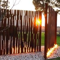 Corten metal screen. Corten is a group of steel alloys which were developed to eliminate the need for painting, and form a stable rust-like appearance if exposed to the weather for several years.