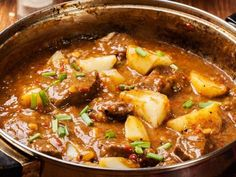 A recipe for Serbian Goulash-Paprikash made with onions, olive oil, lamb, bay leaves, tomato paste, water, paprika, red chile