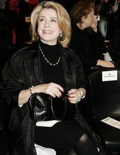 Catherine Deneuve attends the Jean Paul Gaultier fashion show during Paris Fashion Week (Pret-a-Porter) Spring/Summer 2005 October 5, 2004 in Paris, France.
