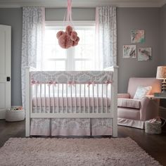"Pink and Gray Rosa Crib Bedding | Pink and Grey Girl Baby Bedding | Carousel Designs. So soft and feminine, Pink and Gray is the ultimate in pastel shades. The modern Suzani print takes on a whole new life in these incredibly sweet shades of pink, silver grey and mist. The soft, plush feel of minky added to the bumper along with the stunning peek-a-boo skirt add the final touches to this ""must have"" bedding collection."