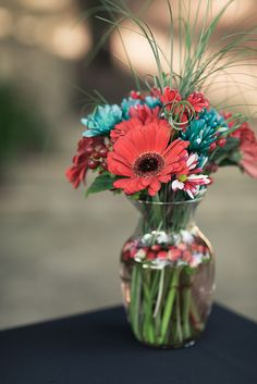 Red and aqua wedding flowers....yellow and aqua maybe?!?!- For more amazing finds and inspiration visit us at http://www.brides-book.com and join the VIB Ciub
