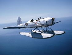 A Ryan Recruit flies over the Pacific off the coast of California, wearing the markings of the Netherlands Air Force. Note the difference in the engines between this shot and the previous – this one a Menasco in-line and the previous shot a Kinner radial.