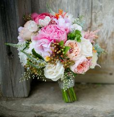 wildflowers mixed with traditional flowers for a warm-weather wedding
