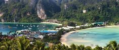 A comprehensive budget travel guide to the Thai island of Ko Phi Phi with tips and advice on things to do, see, ways to save money, and cost information. New Travel, Travel Alone, Solo Travel, Thailand Adventure, Thailand Travel Tips, Niagara Waterfall, Top 10 Tourist Destinations, Thai Islands, Largest Waterfall