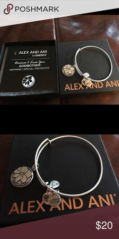 Alex and Ani Silver Godmother bracelet New in box silver godmother bangle bracelet. I thought I was buying the goddaughter bracelet, but bought this by mistake. I had the store clerk cut off the tag because it was for a gift, but it is brand new. I simply bought the wrong one. Alex & Ani Jewelry Bracelets