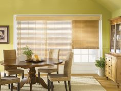 Available in a range of solid and woodgrain colors, faux wood blinds and composite wood blinds give a room distinctive character—light colors add cheerful charm to a kitchen or living room, while dark colors create a thoughtful atmosphere for a study or den. #fauxwood #fauxwoodblinds #blinds #window #windows #homedecor #remodel