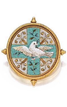 Gold and Micromosaic Brooch, Castellani The circular micromosaic depicting a dove brandishing a laurel branch, composed of tesserae in white, gray, turquoise, olive and gold hues, within a ropetwist frame accented by four finials, signed with interlocking Cs; circa 1865.