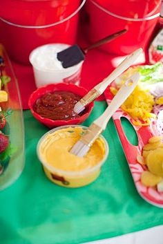 Have kids paint their condiments onto their food.  Great idea for an art party.  New empty paint cans could b used to hold  food or plastic cutlery etc.