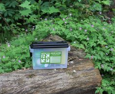 The Official Geocaching HQ Ammo Can with Mini Signal the Frog® Plush.