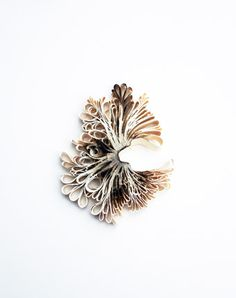 Flóra Vági: Burnt by the Sea, brooch; book pages, cold enamel, 18K gold