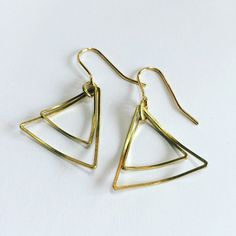 Excited to share this item from my shop: Delicate Curved Triangle Gold Brass Drop Earrings - Geometric - Modern - Simple - Light Chandelier Earrings, Hoop Earrings, Gypsy Witch, Handmade Items, Handmade Gifts, Geometric Jewelry, Design Process, Geometric Shapes, Triangle