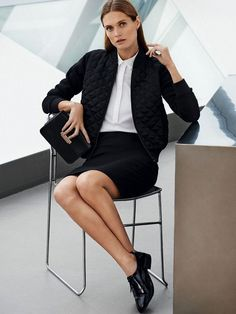 A white button-down shirt is paired with a quilted bomber jacket, pencil skirt, oxfords, and a black mini bag