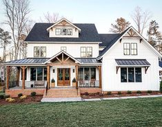 "Hank Bailey RE/MAX Legends on Instagram: ""Love the metal roof over that front porch! 🤩 Stained elements on a black and white modern farmhouse. Black windows and board and batten in…"""