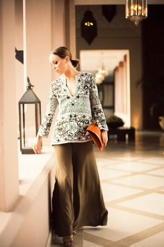 Naeem Khan tunic, Rae Francis pants, and Elie Tahari heels.