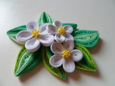 Quilled white flowers