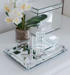 this lovely mirror tray can display your fragrances or collectibles and will enhance your bathroom decor mirrored vanity