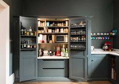 deVol kitchen - Interior view of lighted larder cabinet in a deVol kitchen with Shaker cabinets in Flint gray - deVol Kitchens via Atticmag
