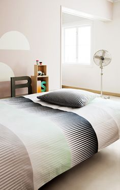 Simple guest room. Love the metallic standing fan too. Haha